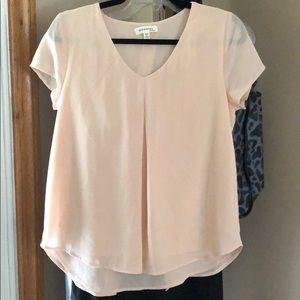 ⭐️Monteau short sleeved blouse/longer in back NWT
